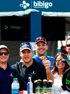 Golf spectators after trying Bibi-cone at the Taste Bibigo booth
