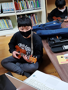 Students in study groups listening to music and playing instruments through a contactless cultural program, Contactless Cultural Play, by CJ Welfare Foundation